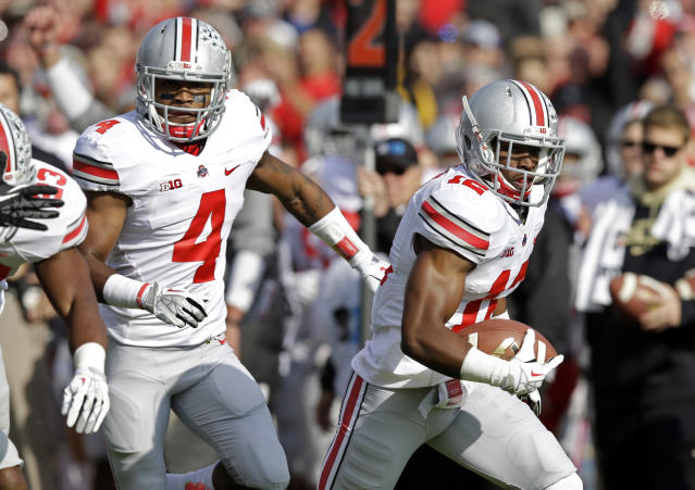 Ohio State cornerback Doran Grant heads to the end zone in front of teammate C.J. Barnett after making an interception against Purdue during the first half of an NCAA college football game in West Lafayette, Ind., Saturday, Nov. 2, 2013. (AP Photo/Michael Conroy)