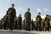 Fighters of the Syrian Democratic Forces, parade at the funeral on November 10, 2018 of a comrade who was among more than 600 killed in the US-backed campaign against the Islamic State group that has been thrown into doubt by US withdrawal plans