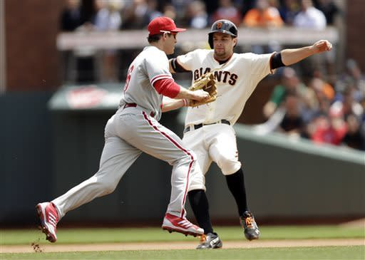 San Francisco Giants' Brandon Belt avoids the tag attempt from Philadelphia Phillies second baseman Chase Utley after a ground ball from Francisco Peguero during the fourth inning of a baseball game on Wednesday, May 8, 2013 in San Francisco. Belt was out later on the play, and Peguero was safe at first. (AP Photo/Marcio Jose Sanchez)