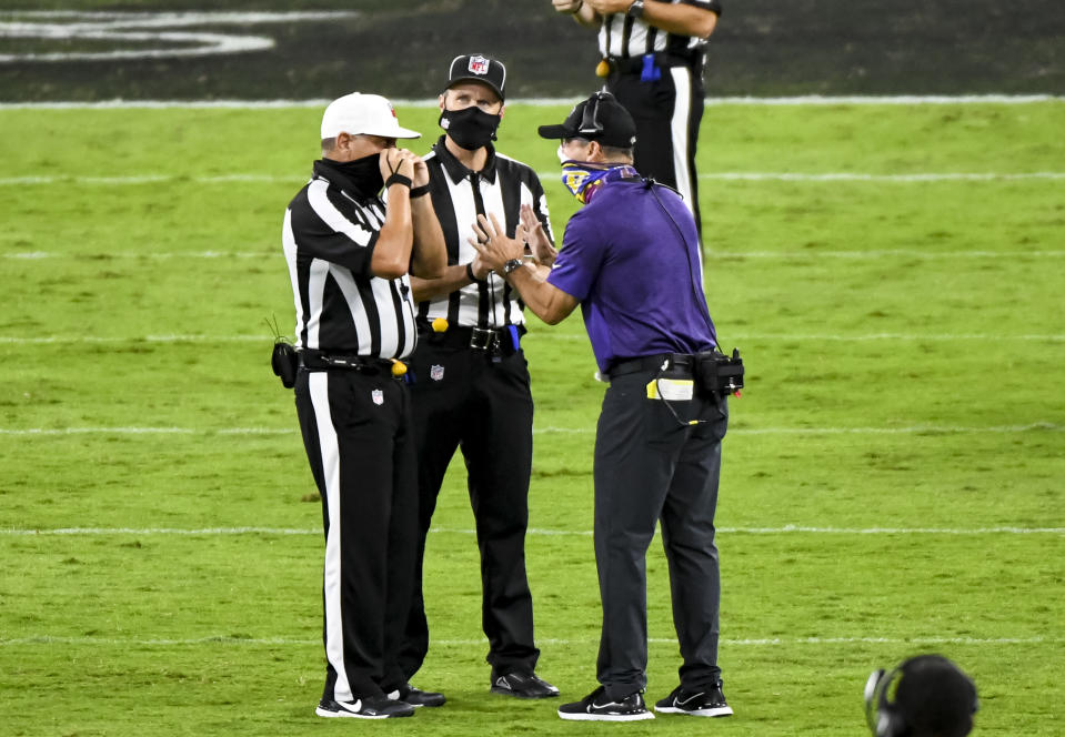 Baltimore Ravens coach John Harbaugh had his mask on here while speaking to game officials against the Kansas City Chiefs, but not on a separate occasion. (Photo by Mark Goldman/Icon Sportswire via Getty Images)