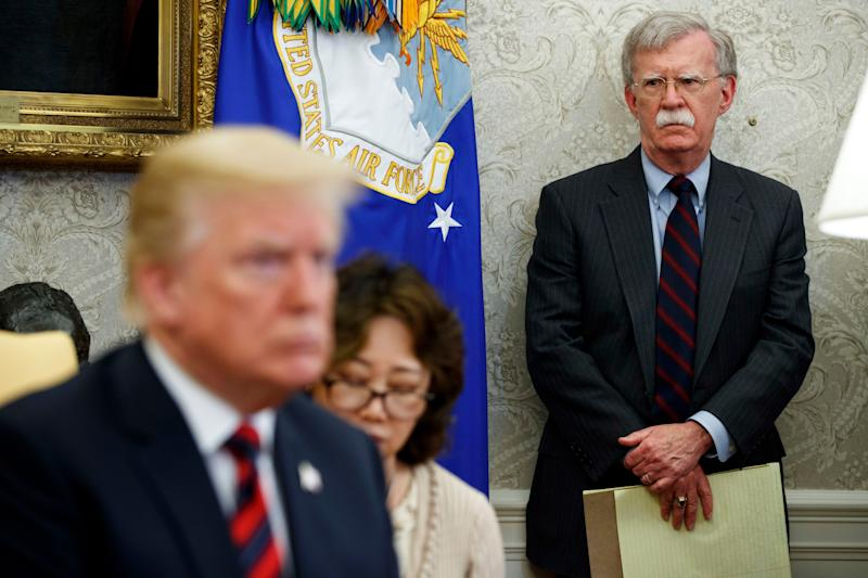 Then-national security adviser John Bolton watches as President Donald Trump meets with South Korean President Moon Jae-in on May 22, 2018.