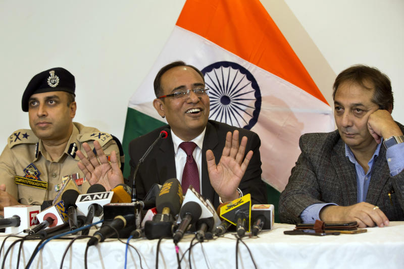 Government spokesperson Rohit Kansal, center, speaks as Swayam Prakash Pani, Inspector General of Police of Kashmir Range, left, and Divisional Commissioner Baseer Khan sit beside him during a press conference in Srinagar, Indian controlled Kashmir, Saturday, Oct. 12 2019. The Indian government on Saturday announced that all post paid mobile phone will be restored on Oct. 14, 70 days after a communication blockade was put in place in disputed Kashmir. (AP Photo/Dar Yasin)