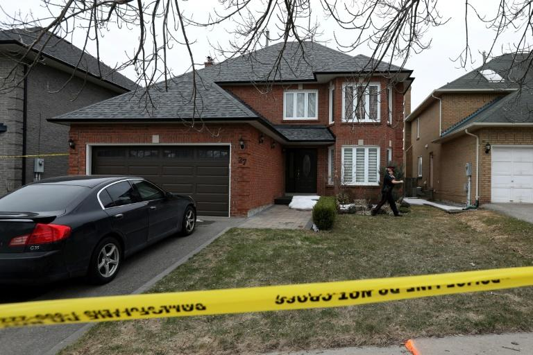 A police officer walks around the house of the van massacre suspect Alek Minassian in the Toronto suburb of Richmond Hill