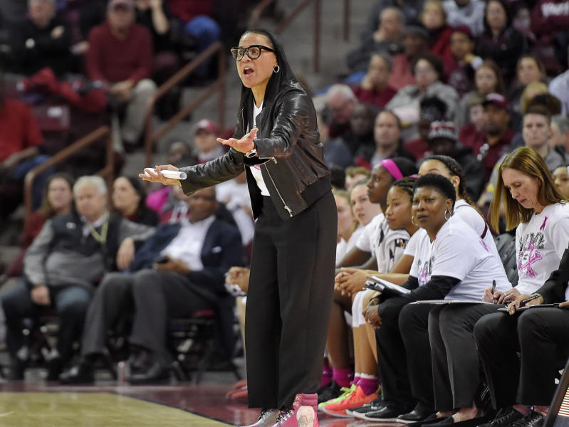 South Carolina head coach Dawn Staley, center, reacts during the first half of an NCAA college basketball game against LSU, Thursday, Feb. 20, 2020, in Columbia, S.C. (AP Photo/Richard Shiro)