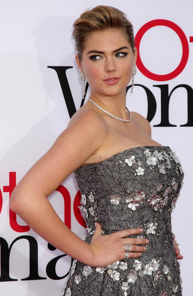 Kate Upton certainly looks buxom, but her floral dress is no match for Cameron's revealing number