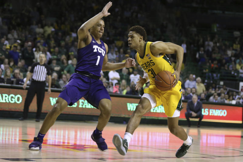 Baylor guard MaCio Teague, right, drives on TCU guard Desmond Bane, left, in the second half of an NCAA college basketball game, Saturday, Feb. 1, 2020, in Waco, Texas. Baylor won 68-52. (AP Photo/Rod Aydelotte)