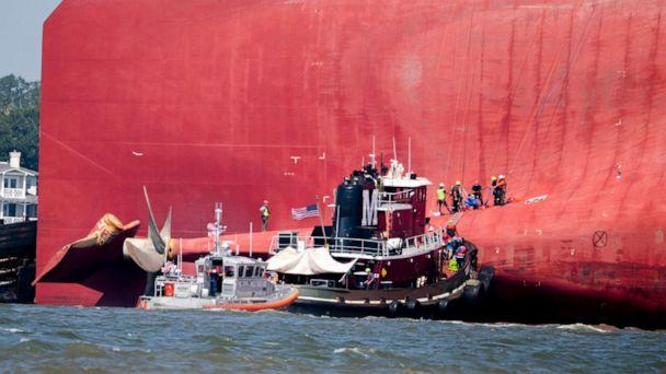 PHOTO: Rescuers work near the stern of the vessel Golden Ray as it lays on its side near the Moran tug boat Dorothy Moran, Sept. 9, 2019, in Jekyll Island, Ga. (Stephen B. Morton/AP)