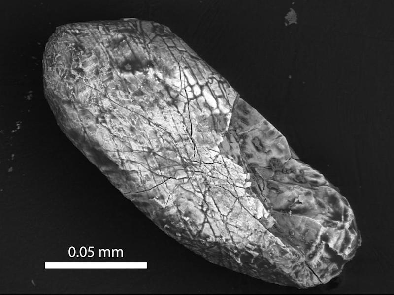 Oldest Crystals on Earth Originated in Asteroid Craters