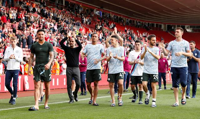 "Soccer Football - Premier League - Southampton vs Manchester City - St Mary's Stadium, Southampton, Britain - May 13, 2018 Manchester City manager Pep Guardiola and his players applaud fans after the match Action Images via Reuters/John Sibley EDITORIAL USE ONLY. No use with unauthorized audio, video, data, fixture lists, club/league logos or ""live"" services. Online in-match use limited to 75 images, no video emulation. No use in betting, games or single club/league/player publications. Please contact your account representative for further details."