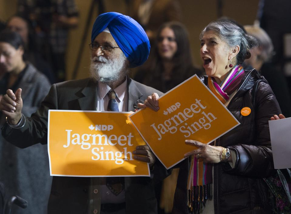 NDP supporters cheers while watching the live results stream in at NDP leader Jagmeet Singh's election night headquarters in Burnaby, B.C., on Monday, October 21, 2019. THE CANADIAN PRESS/Nathan Denette