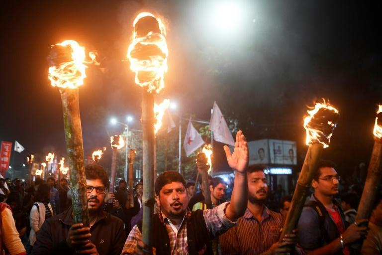 Leftist student group members take part in a torch rally in Kolkata to protest India's new citizenship law, which critics say is anti-Muslim (AFP Photo/Dibyangshu SARKAR)