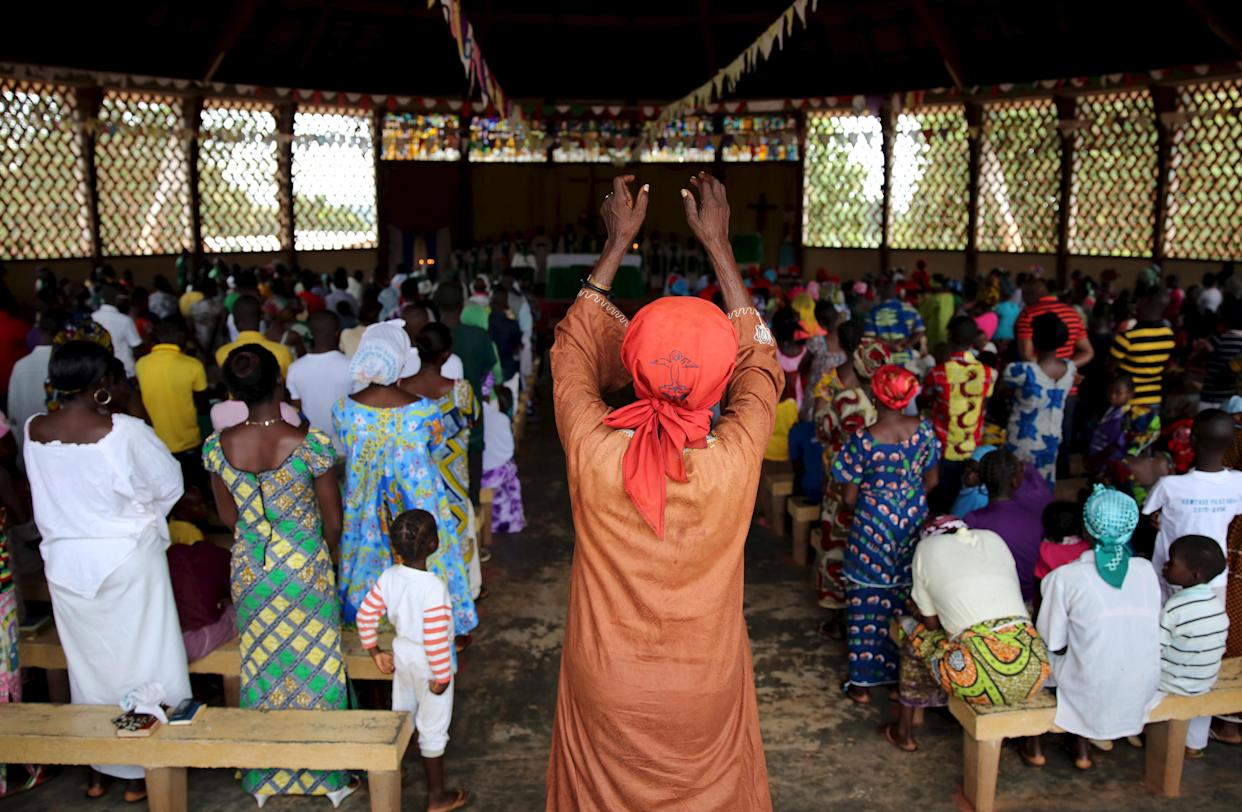 Faithful pray during a Sunday Mass in Saint Joseph Cathedral in Bambari, Central African Republic, on Oct. 18, 2015. (Photo: Goran Tomasevic/Reuters)