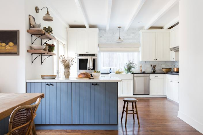 "<div class=""caption""> The kitchen remodel was the hardest part of the four-month-long renovation and involved moving the entire island from one side to the other. Boesch chose <a href=""https://www.benjaminmoore.com/en-us"" rel=""nofollow noopener"" target=""_blank"" data-ylk=""slk:Benjamin Moore"" class=""link rapid-noclick-resp"">Benjamin Moore</a> Trout Gray for the island and Cloud Cover for the other cabinets. The floating shelves are walnut and custom-cut with brackets from <a href=""https://www.rejuvenation.com/"" rel=""nofollow noopener"" target=""_blank"" data-ylk=""slk:Rejuvenation"" class=""link rapid-noclick-resp"">Rejuvenation</a>; the backsplash tile is from <a href=""https://www.annsacks.com/"" rel=""nofollow noopener"" target=""_blank"" data-ylk=""slk:Ann Sacks"" class=""link rapid-noclick-resp"">Ann Sacks</a>. </div>"