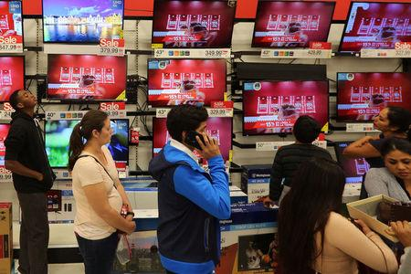 Shoppers stand in a checkout line during Black Friday sales at a Target store in Culver City, California, U.S. November 25, 2016.  REUTERS/David McNew