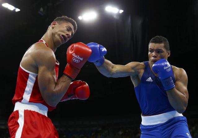 2016 Rio Olympics - Boxing - Final - Men's Super Heavy (+91kg) Final Bout 273 - Riocentro - Pavilion 6 - Rio de Janeiro, Brazil - 21/08/2016. Tony Yoka (FRA) of France and Joseph Joyce (GBR) of Britain compete. REUTERS/Peter Cziborra FOR EDITORIAL USE ONLY. NOT FOR SALE FOR MARKETING OR ADVERTISING CAMPAIGNS.