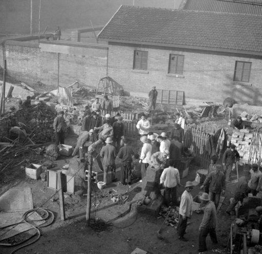 "File picture. Employees of the Shin Chiao Hotel in Beijing build in the hotel courtyard in October 1958 a small and rudimentary smelting steel furnace during the period of the ""Great Leap Forward"" (1958-1959). Tens of millions of people died in the initiative that was launched by Mao Zedong, but the subject is taboo in modern-day China"