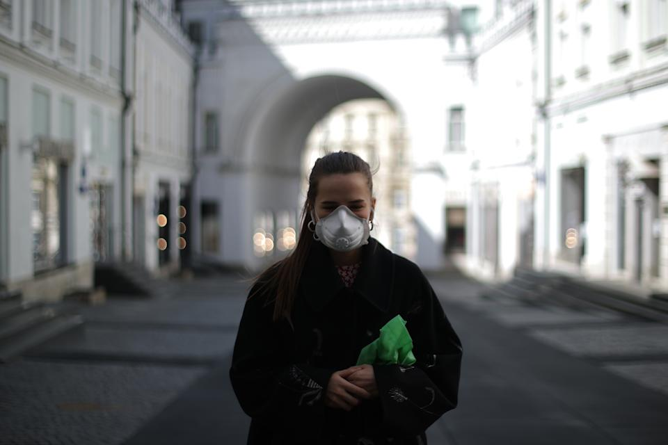 MOSCOW, RUSSIA - APRIL 29, 2020: A young girl in Tretyakovsky Proyezd Street. Russian President Vladimir Putin has expanded non-working period till May 11, 2020 to prevent the spread of the novel coronavirus. Mikhail Tereshchenko/TASS (Photo by Mikhail Tereshchenko\TASS via Getty Images)