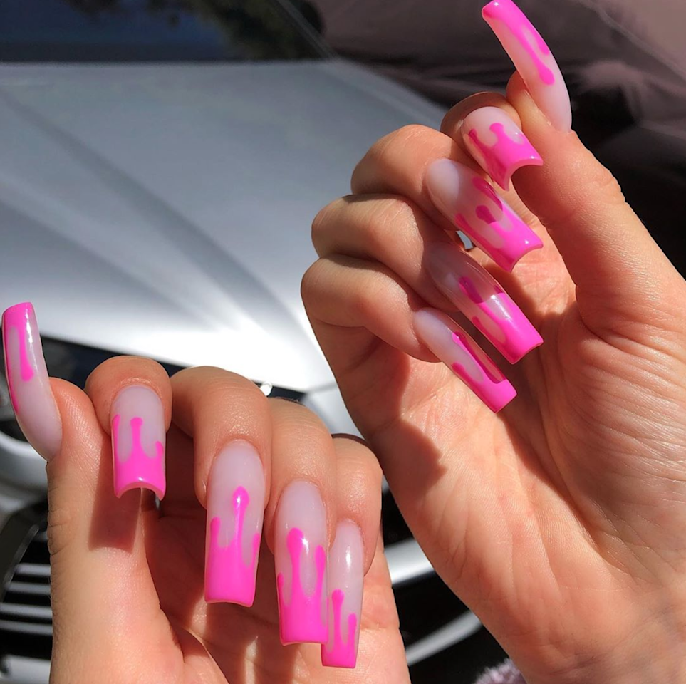 "While the 22-year-old makeup mogul seems to have a different manicure every week (thanks to nail artist <a href=""https://www.instagram.com/chaunlegend/"">Chaun P. Legend</a>), this recent hot pink design reminiscent of her Kylie Lip Kit packaging is a definite favorite. Jenner showed off her neon digits on Instagram with the caption, ""French Drip😍💗💗💗✨."""
