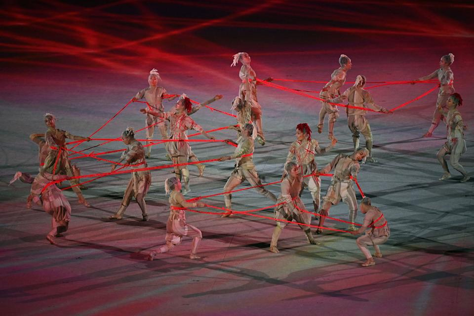 Pictured here, performers take part in the opening ceremony of the Tokyo Olympic Games.