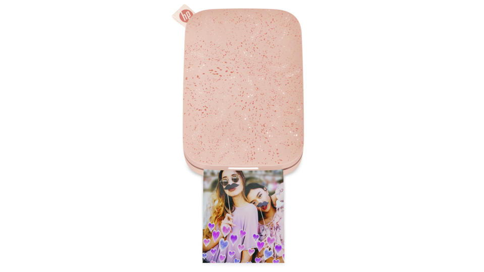 """<p>Remember printed photos? News flash: They're still pretty great! But this <a href=""""https://www.amazon.com/HP-Sprocket-Instant-Printer-1AS91A/dp/B07GFP7H8C?&linkCode=ll1&tag=ewmothersdaygiftguidebkaplan0421-20&linkId=ecc77ae8d7f411a2181cc49fca314916&language=en_US&ref_=as_li_ss_tl"""" rel=""""nofollow noopener"""" target=""""_blank"""" data-ylk=""""slk:mini printer"""" class=""""link rapid-noclick-resp"""">mini printer</a> takes things up a notch by allowing you to personalize your pics with fun stickers and frames.</p> <p><strong>$79, <a href=""""https://www.amazon.com/HP-Sprocket-Instant-Printer-1AS91A/dp/B07GFP7H8C?&linkCode=ll1&tag=ewmothersdaygiftguidebkaplan0421-20&linkId=ecc77ae8d7f411a2181cc49fca314916&language=en_US&ref_=as_li_ss_tl"""" rel=""""nofollow noopener"""" target=""""_blank"""" data-ylk=""""slk:amazon.com"""" class=""""link rapid-noclick-resp"""">amazon.com</a></strong></p>"""