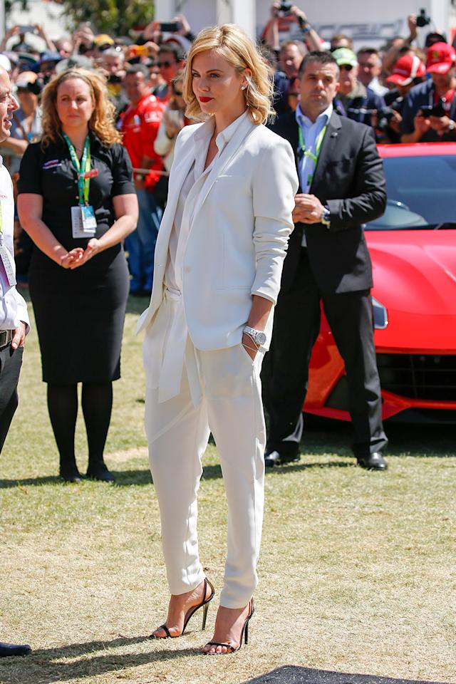 <p>Charlize Theron kept things casual in white tapered pants and boyfriend-style jacket as she made an appearance for Capitol Grand on race day for the 2015 Australian Formula 1 Grand Prix on March 15, 2015 in Melbourne, Australia. (Photo: Chris Putnam / Barcroft Media via Getty Images) </p>
