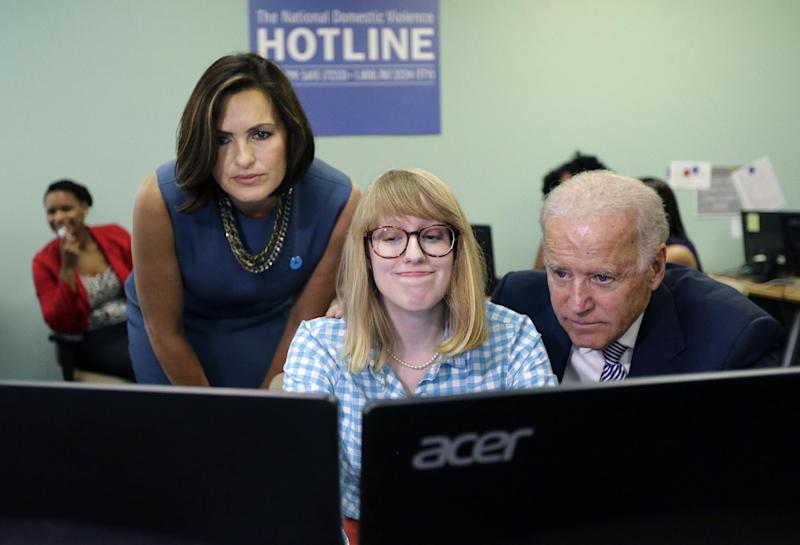 Vice President Joe Biden, right, and actress Mariska Hargitay, left, visit the headquarters of the National Domestic Violence Hotline in West Lake Hills, Texas, Wednesday, Oct. 30, 2013, to help commemorate National Domestic Violence Awareness Month (AP Photo/Eric Gay)