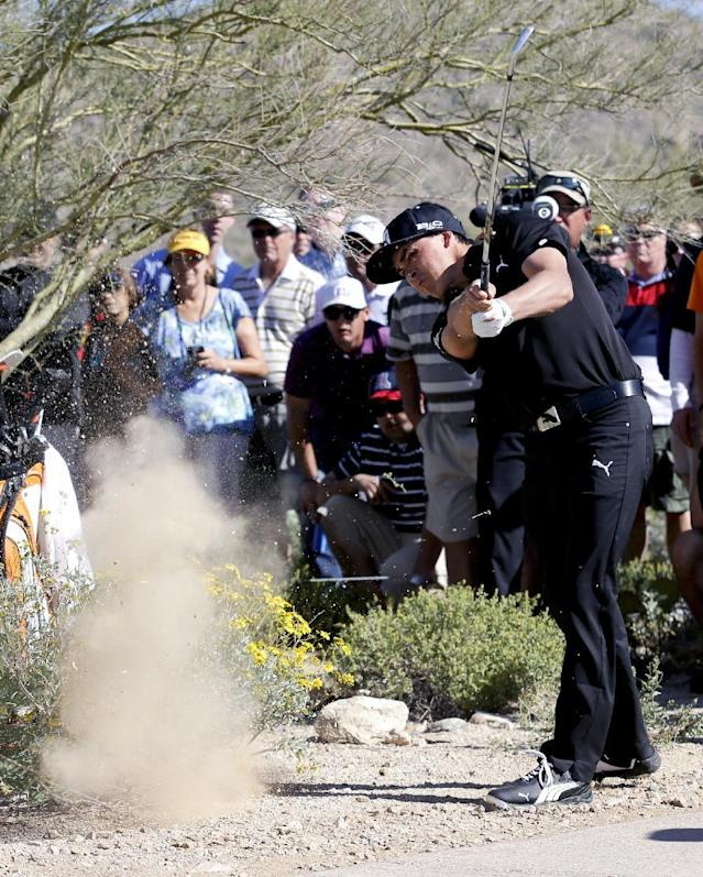Rickie Fowler hits form the desert on the second hole in his match against Jim Furyk during the fourth round of the Match Play Championship golf tournament on Saturday, Feb. 22, 2014, in Marana, Ariz. (AP Photo/Ted S. Warren)