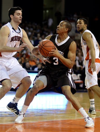 Lehigh's C.J. McCollum (3) looks for a shot around Bucknell's Bryan Cohen (4) during the first half of an NCAA college basketball game in the men's Patriot League tournament in Lewisburg, Pa., on Wednesday, March 7, 2012. (AP Photo/Ralph Wilson)