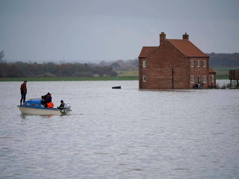 A flooded farm near Lincoln after a river broke its banks; hundreds of people have had to evacuate their homes: Getty