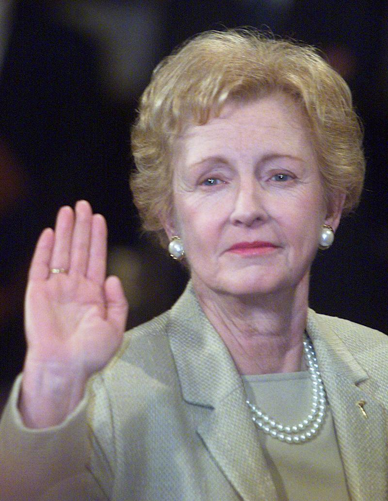 """<a href=""""http://www.senate.gov/artandhistory/history/common/briefing/women_senators.htm""""><strong>Served from:</strong></a> 2001-02 Sen. Jean Carnahan (D-Mo.) raises her right hand on January 3, 2001 during a swearing in ceremony in Washington. (Photo by Mark Wilson/Newsmakers)"""