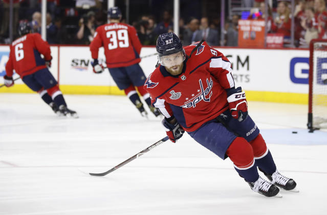 FILE - In this Saturday, June 2, 2018 file photo, Washington Capitals forward Evgeny Kuznetsov, of Russia, warms up before Game 3 of the team's NHL hockey Stanley Cup Final against the Vegas Golden Knights, in Washington. Washington Capitals center Evgeny Kuznetsov tested positive for cocaine at the world championship and has been banned from the Russian national team for four years. The IIHF says the ban expires on June 12, 2023. The ban does not affect Kuznetsov playing for the Capitals, who won the 2018 Stanley Cup. (AP Photo/Alex Brandon, File)