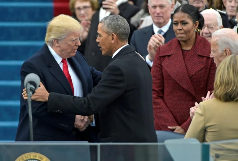 Barack Obama greets Donald Trump as he arrives on the platform at the US Capitol in Washington, DC for his swearing-in ceremony in January 2017