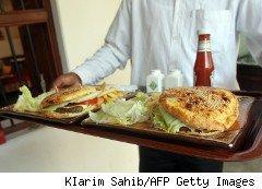 Restaurant waiter delivering a tray of food