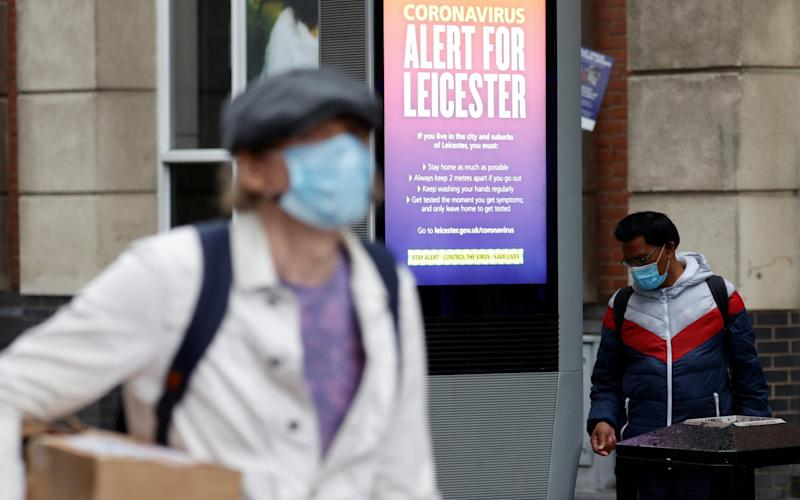 An NHS alert message is seen on a street, following a local lockdown imposed amid the coronavirus disease (COVID-19) outbreak, in Leicester - PHIL NOBLE/REUTERS