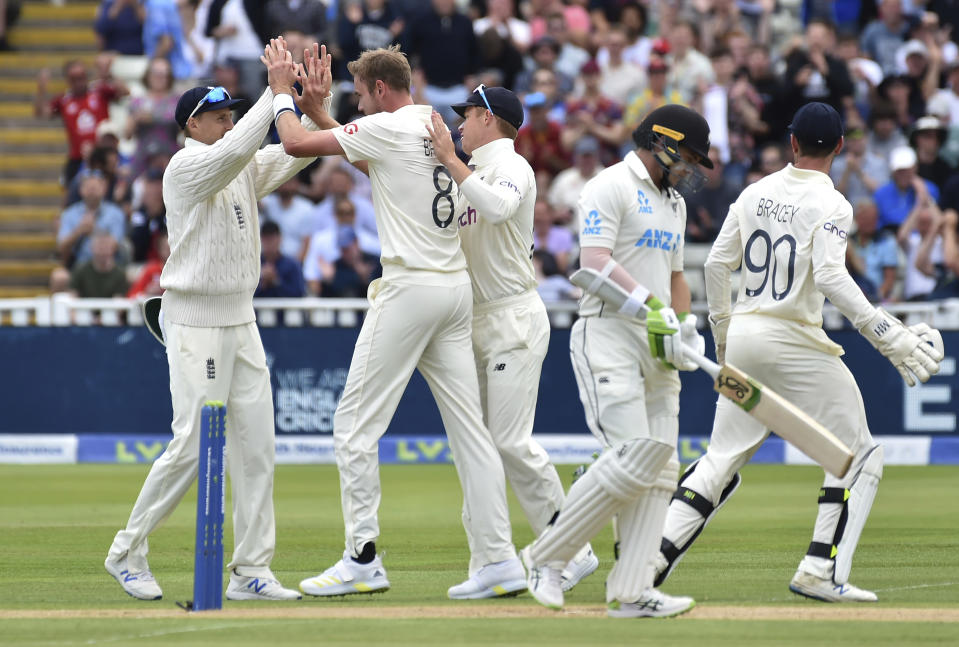 England's Stuart Broad, second left, celebrates with teammates the dismissal of New Zealand's captain Tom Latham, second right, during the second day of the second cricket test match between England and New Zealand at Edgbaston in Birmingham, England, Friday, June 11, 2021. (AP Photo/Rui Vieira)