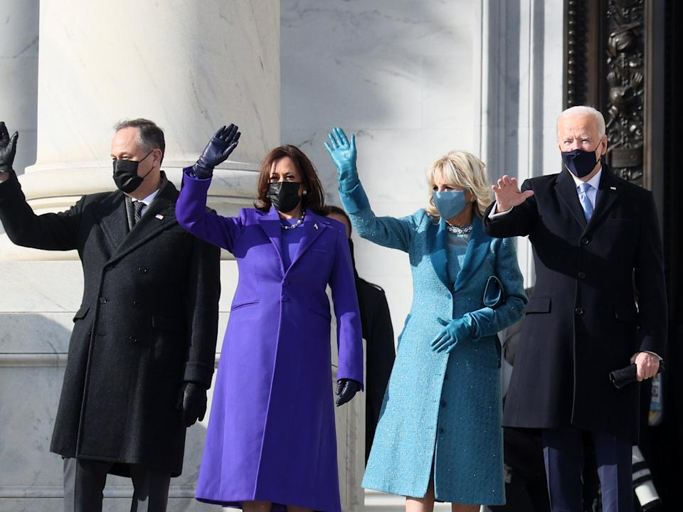 Joe Biden, Kamala Harris, Jill Biden, and Doug Emhoff wave as they arrive on the East Front of the Capitol for the inauguration ceremonyGetty Images