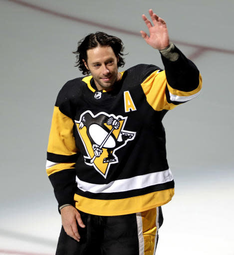 Pittsburgh Penguins' Matt Cullen waves to fans during a pre-game celebration of his 1500th career NHL hockey game against the Florida Panthers in Pittsburgh, Tuesday, March 5, 2019. Cullen joins Chris Chelios as the only two American-born players to accomplish the feat. (AP Photo/Gene J. Puskar)