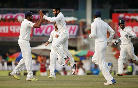 India v Australia - Third Test cricket match - Jharkhand State Cricket Association Stadium, Ranchi, India - 19/03/17 - India's Ravindra Jadeja (2nd L) celebrates with his teammates after dismissing Australia's Nathan Lyon. REUTERS/Adnan Abidi
