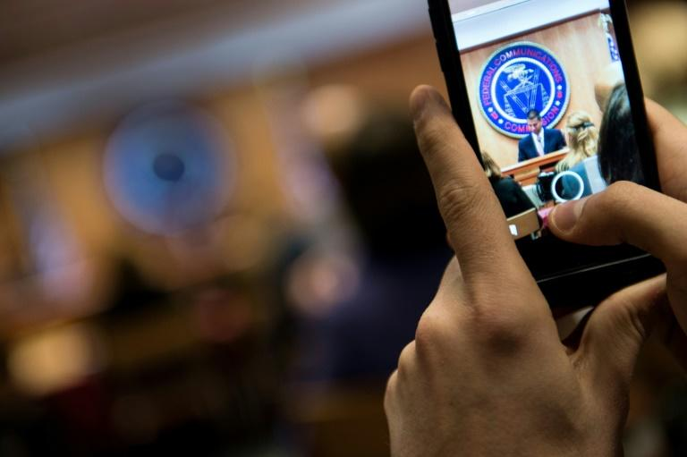 "A person records proceedings during a hearing at the Federal Communications Commission meeting on ""net neutrality"" rules"