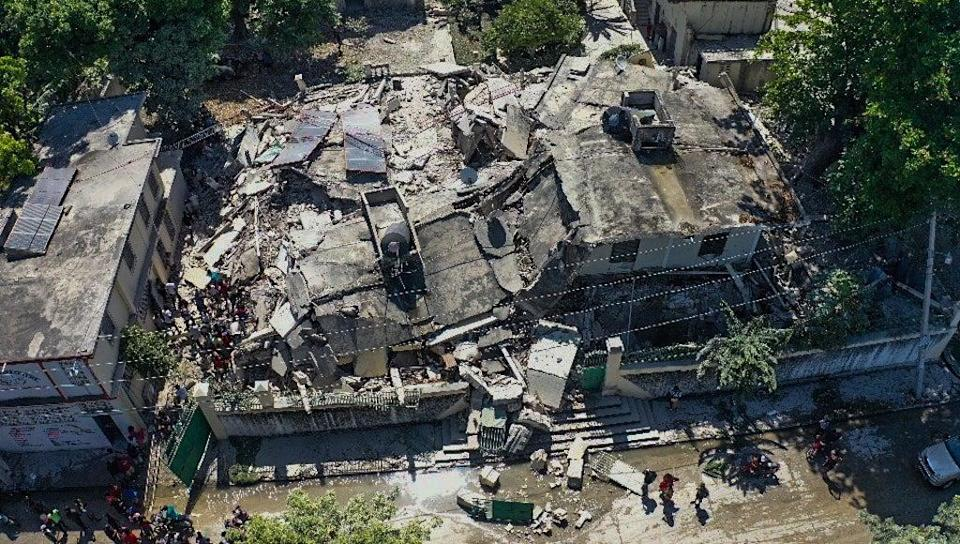 A drone photograph of the damage caused by a 7.2 magnitude earthquake in Los Cayos, Haiti, 14 August 2021 (EPA)