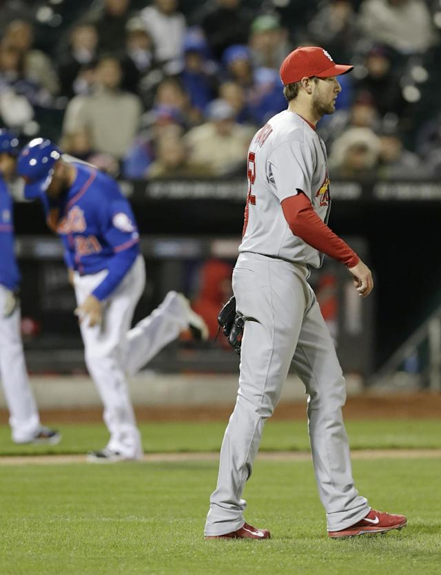 St. Louis Cardinals starting pitcher Michael Wacha, right, reacts after walking New York Mets' Kirk Nieuwenhuis for a run during the fourth inning of a baseball game on Wednesday, April 23, 2014, in New York. (AP Photo/Frank Franklin II)