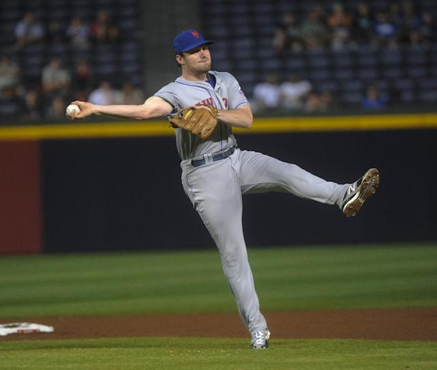 New York Mets second baseman Daniel Murphy throws out Atlanta Braves' Jason Heyward on a ground ball at first base during the fourth inning of a baseball game, Monday, June 17, 2013, in Atlanta. (AP Photo/John Amis)