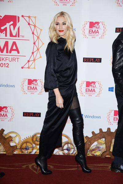 Gwen Stefani: The rock 'n roll princess is a sexy goth in thigh-high stiletto boots and a billowing gown with a super high slit that shows off her legs. (Photo by Venturelli/WireImage)