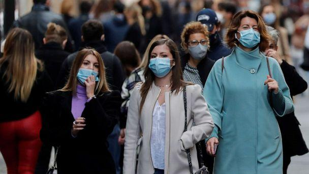 PHOTO: People wearing protective masks walk along the principal shopping street of Via del Corso, as the number of people infected by COVID-19 continues to rise, in Rome, Nov. 14, 2020. (Remo Casilli/Reuters)