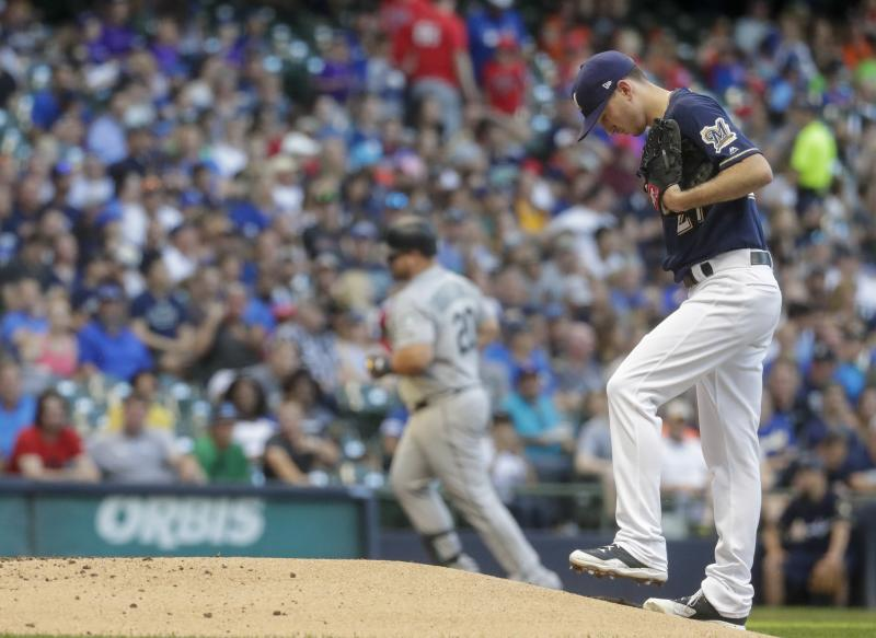 Milwaukee Brewers starting pitcher Zach Davies reacts after giving up a home run to Seattle Mariners' Daniel Vogelbach during the third inning of a baseball game Tuesday, June 25, 2019, in Milwaukee. (AP Photo/Morry Gash)