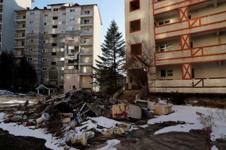FILE PHOTO: Empty buildings are seen at the abandoned Alps Ski Resort located near the demilitarized zone separating the two Koreas in Goseong, South Korea, February 6, 2018.  REUTERS/Jorge Silva