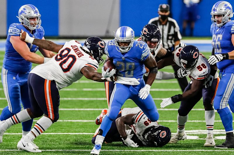Detroit Lions running back Adrian Peterson runs against Chicago Bears defensive tackle John Jenkins (90) during the second half at Ford Field, Sunday, Sept. 13, 2020.