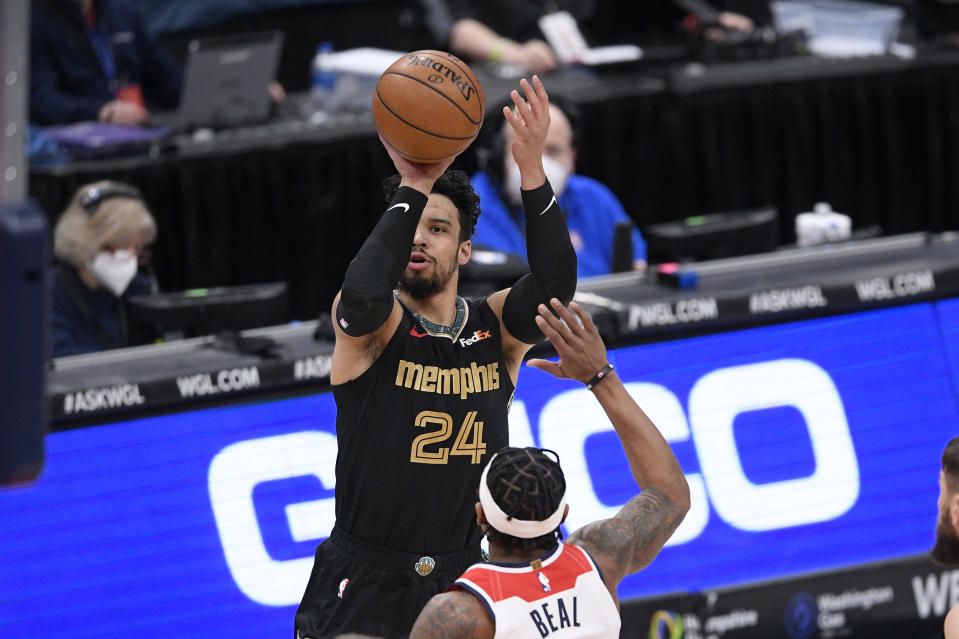 Memphis Grizzlies guard Dillon Brooks (24) shoots against Washington Wizards guard Bradley Beal (3) during the first half of an NBA basketball game, Tuesday, March 2, 2021, in Washington. (AP Photo/Nick Wass)