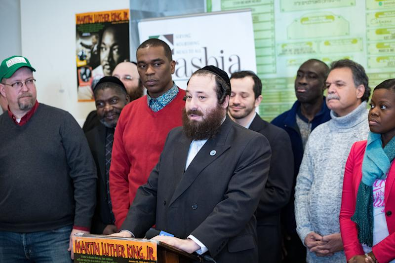 Rockland County legislator Aron Wieder, center, speaks at a Martin Luther King Day event in Brooklyn's Borough Park neighborhood. The event showcased Black-Jewish solidarity. (Photo: Benjamin Kanter)