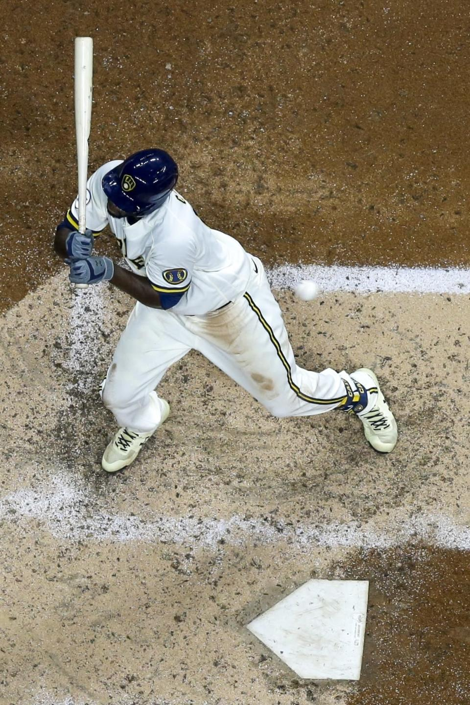 Milwaukee Brewers' Lorenzo Cain is hit by a pitch during the sixth inning of a baseball game against the St. Louis Cardinals Wednesday, May 12, 2021, in Milwaukee. (AP Photo/Morry Gash)